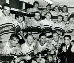 Boston party: Bangor captain Don Whittle celebrates with the rest of his team at winning the Smithwick's Boston Floodlit Cup earlier this week. Bangor beat Malone 20-6 at Upritchard Park to earn the trophy for the 11th time in its history, and now go on to meet Old Belvedere in the All-Ireland Floodlit Challenge on February 19. Included is Smithwick's marketing manager Les Fryer (right). 02/01/1993