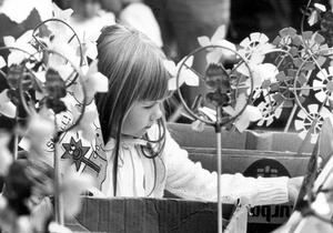 Five-year-old Sarah Darrah from Jordanstown selects a flag while visiting Bangor Market with her mother. 23/7/1983