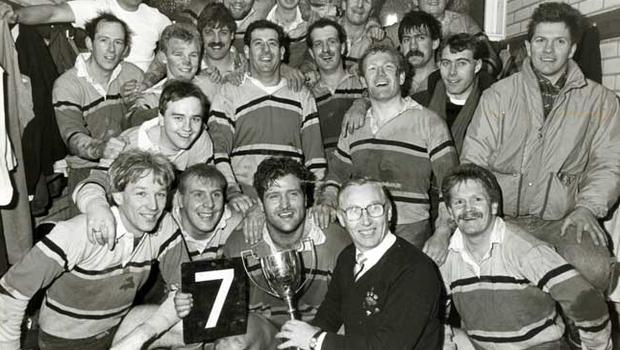 Mr. John Simms (Bass Ireland) presenting the trophy to Bangor captain, Ashley Armstrong, after beating Ballymena 11-6 in the final of the Bass boston Floodlit Cup at Upritchard Park, Bangor, last night. 17/12/1986