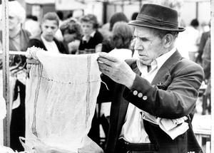 An eye for a bargain - this customer check out the goods at Bangor Market. 20/7/1983