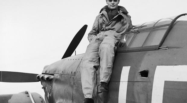 Douglas Bader, a renowned flying ace in World War II, outside the cockpit of his Hawker Hurricane