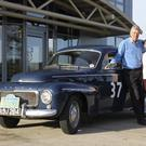 Denis and Jill Wilson with the Volvo PV 544 in which they will travel to Mandalay