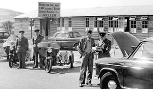 Customs officers check cars at the old Killen-Carrickarnon border post