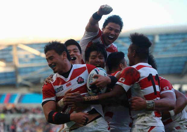 Ayumu Goromaru of Japan celebrates scoring his team's second try during the 2015 Rugby World Cup Pool B match between South Africa and Japan at the Brighton Community Stadium. (Photo by Charlie Crowhurst/Getty Images).