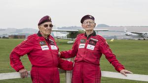D-Day veterans Ted Pieri, left, and Fred Glover, both 90, after they made a tandem parachute jump at Salisbury's Old Sarum Airfield
