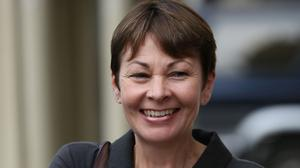 "Caroline Lucas held up a poster demanding ""climate action"" from the Government during Prime Minister's Questions"