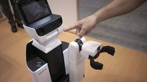 """HSR, short for """"human support robot"""" on show at a welfare and nursing exposition in Yokohama (AP)"""