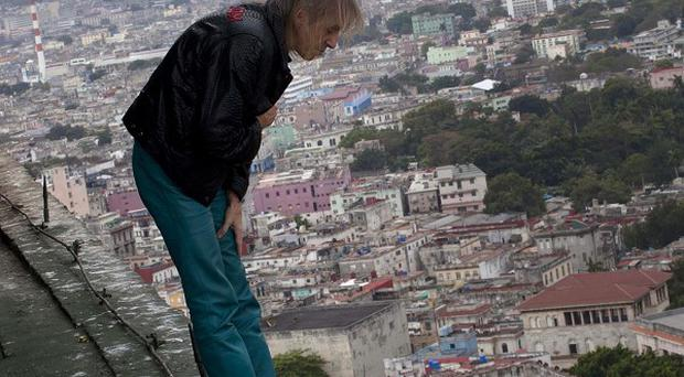 Alain Robert looks over the edge from the roof of the Habana Libre hotel in Havana, Cuba (AP/Ramon Espinosa)