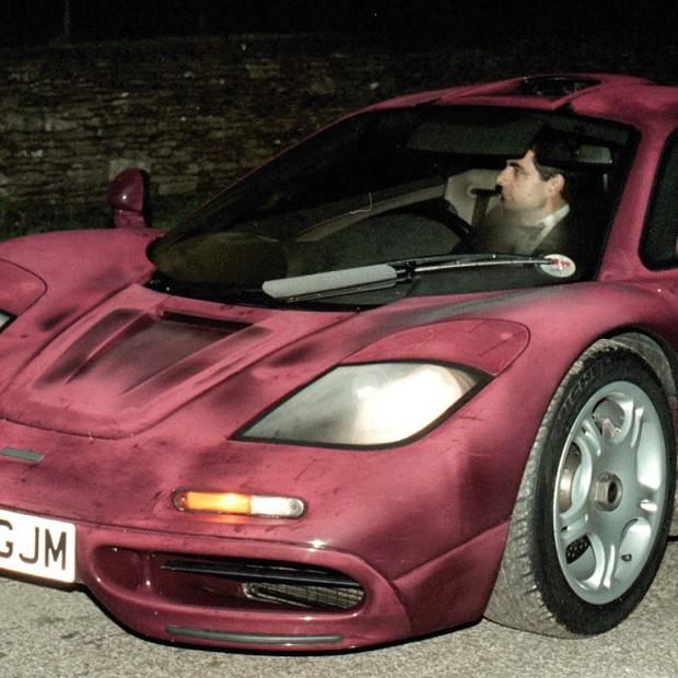 Comedian Rowan Atkinson at the wheel of his McLaren F1 sports car