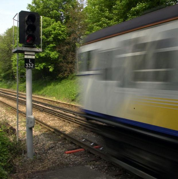 Passengers were delayed on a train between Hereford and London after the signalman got stuck in a toilet