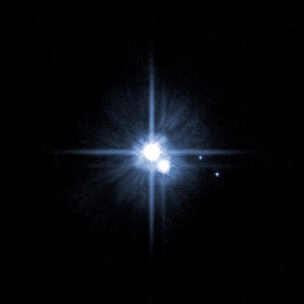 Astronomers have announced a contest to name two of Pluto's moons, discovered over the past two years (AP)