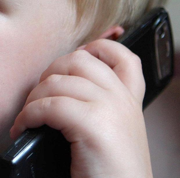A five-year-old boy who had never used a phone called police after his mother became trapped in her bedroom