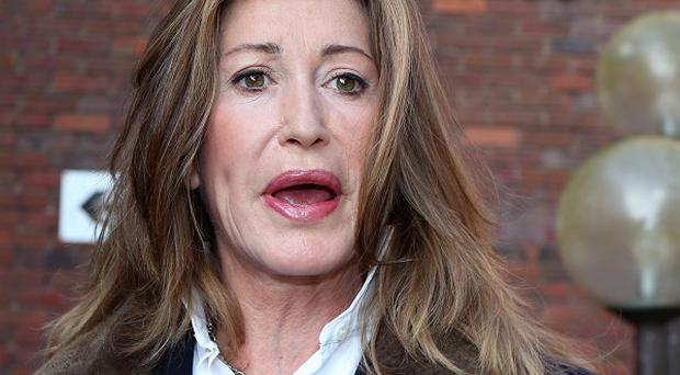 Paula Hamilton leaves Aylesbury Magistrates Court after being convicted of assaulting a policeman with a 14ft sunflower