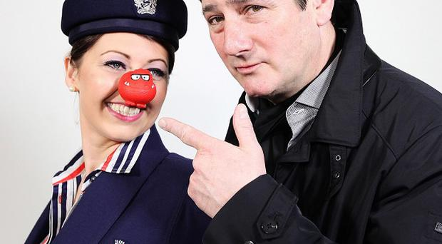 Tony Hadley gets ready for his gig in the sky with a member of British Airways cabin crew (BA/PA)