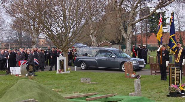 Strangers attend the funeral of former Royal Marine James McConnell