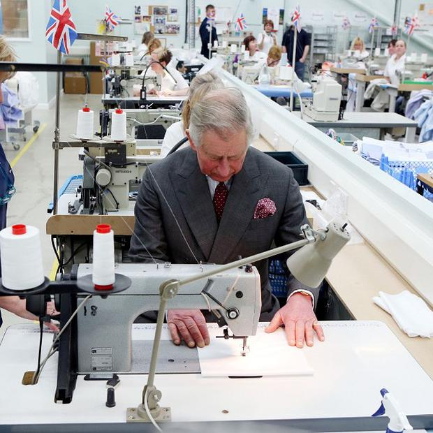 Prince Charles sat behind a sewing machine when he visited the factory of his favourite shirt maker, Turnbull & Asser