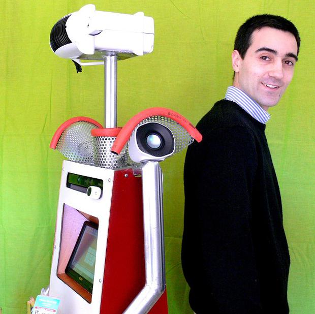 Robot P37 S65 with University of Salford researcher Antonio Espingardeiro (University of Salford/PA)