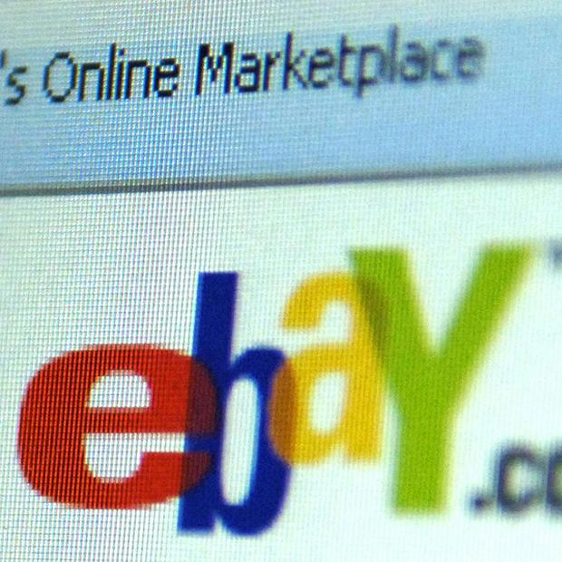 eBay has apologised after 'dozens' of items relating to the Holocaust were listed on its site