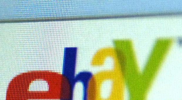 Auction site eBay is joining forces with retailer Argos