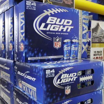 A lawsuit accuses the makers of Bud Light and several other drinks of cheating consumers out of the stated alcohol percentage by adding water (AP)