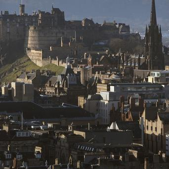The grave of a medieval knight has been found under an old car park in Edinburgh