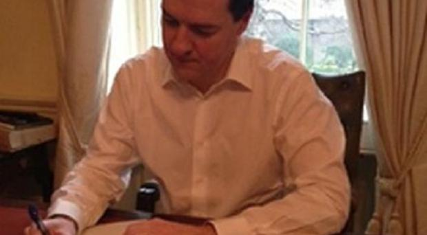George Osborne's tweet showed him putting a final touch to his Budget statement (George Osborne/Twitter/PA)