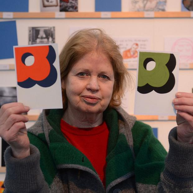Dee Refaie with her postcard by the fashion designer Orla Kiely which she paid 45 pounds for at the Royal College of Art annual postcard sale