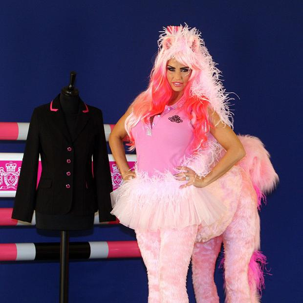 Katie Price dresses as a horse to mark the 5th birthday of KP Equestrian