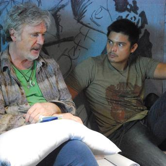 Irish actor Patrick Bergin, left, talks to Filipino heartthrob Dingdong Dantes during a scene in Dance of the Steel Bars (Portfolio Films/AP)