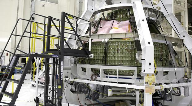 The Orion Exploration Flight Test 1 crew module at the Kennedy Space Centre in Cape Canaveral, Florida (AP)