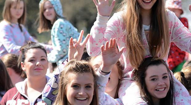 Hundreds of eople gathered at Drayton Manor Theme Park in Tamworth, in an attempt to break the record for the largest gathering of people wearing onesies (PA/Drayton Manor)