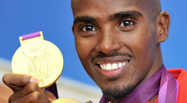 Mo Farah said he was 'excited' for the London Marathon as he ran to catch the bus after sleeping in