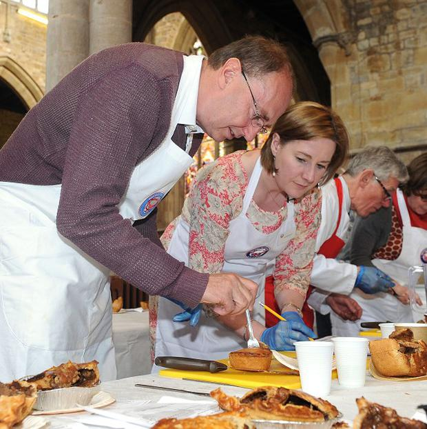 Cricketing commentator Jonathan Agnew takes part in the judging at the British Pie Awards, St Marys Church, Melton Mowbray