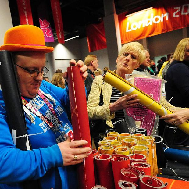 Members of the public attend the sale of hundreds of items that were used during the London 2012 Olympics