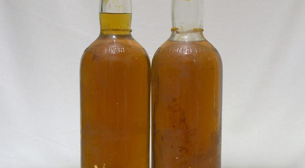 Two rare bottles of whisky salvaged from a shipwreck which inspired a book and film