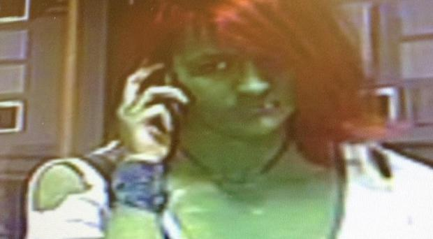 CCTV footage of a woman police are hunting who was dressed as the Hulk when she allegedly attacked another woman outside a restaurant