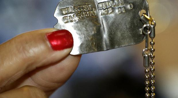 The dog tags that belong to Willie Wilkins, who lost them while serving in France in August 1944 (AP/Julio Cortez)