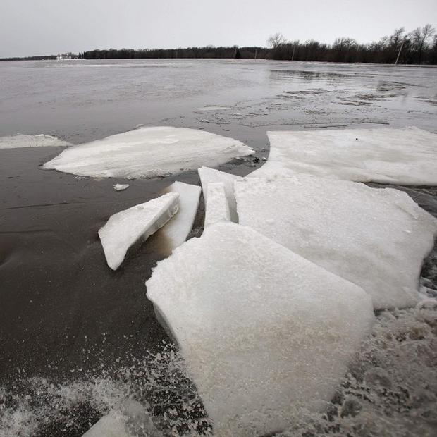 Huge ice sheets were pushed ashore at a Minnesota lake (AP)