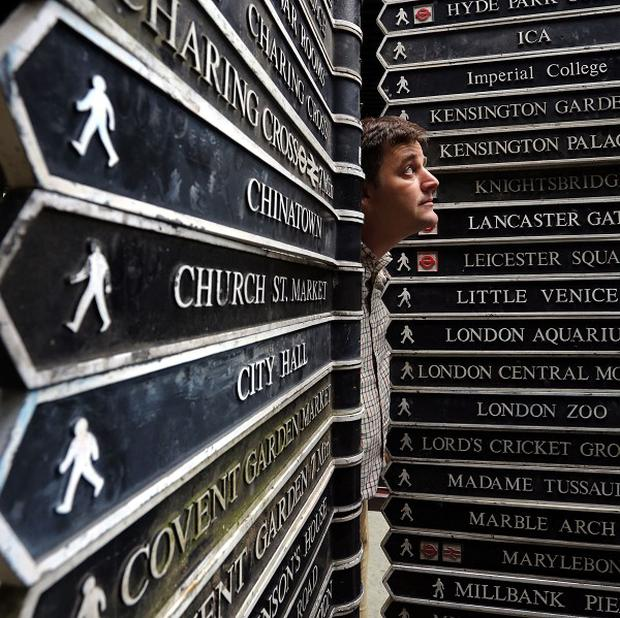 Rupert van der Werff of Summers Place Auctions in Billingshurst, West Sussex, prepares over 300 historic London street signs for auction