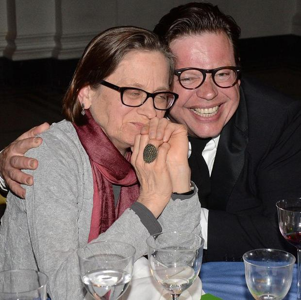 Lydia Davis is congratulated by publisher Simon Prosser as she wins this year's Man Booker International Prize