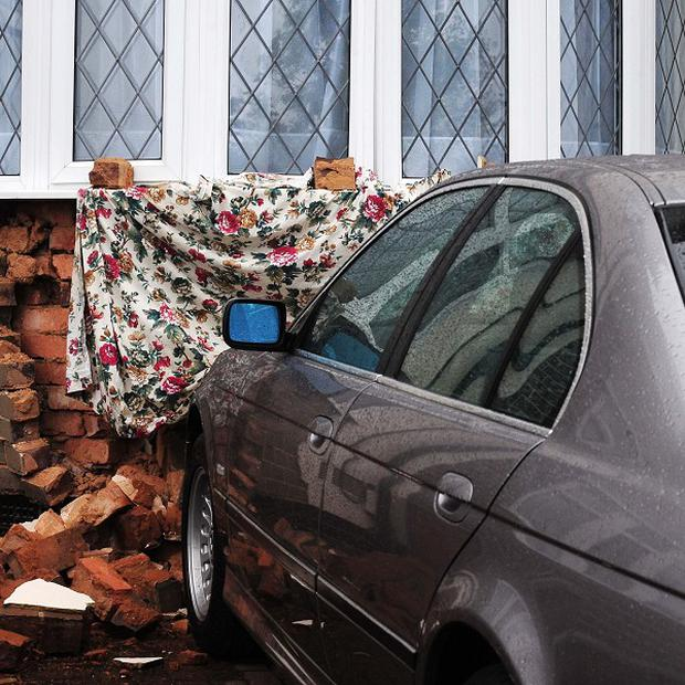The parked car was hit by a van which pushed it into the wall of a Coventry house