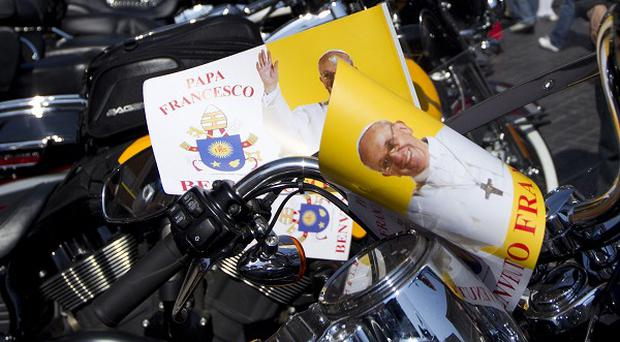 Harley Davidson motorcycles riders park their motorcycles in Via della Conciliazione leading to the Vatican (AP)