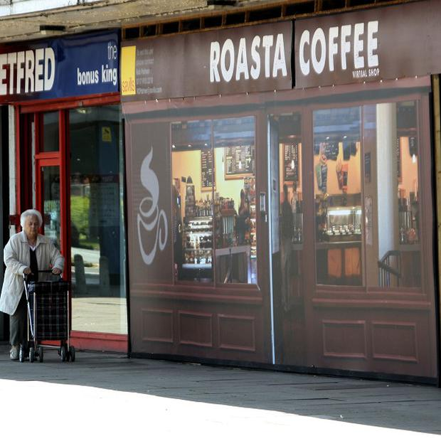 A woman walks past the fake 'Roasta Coffee' outlet at Coronation Square shopping centre in Cheltenham