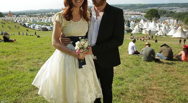 Newlywed festivalgoers John and Mathilda Fristrom Eldridge, from Newquay, enjoy their honeymoon at the Glastonbury Festival