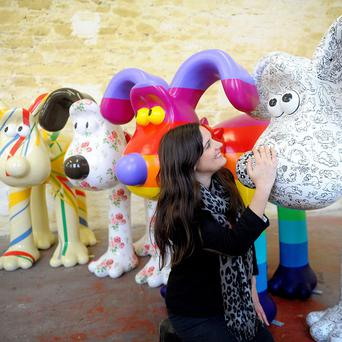 Lauren Vincent, of Gromit Unleashed, poses with sculptures painted by Sir Paul Smith, Cath Kidston, Richard Williams and Simon Tofield