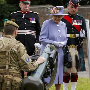 The Queen views ordnance during her visit to Howe Barracks in Canterbury