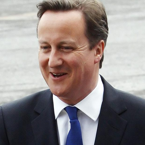 Prime Minister David Cameron said he still gets told off by his former Oxford tutors for mistakes in running the country