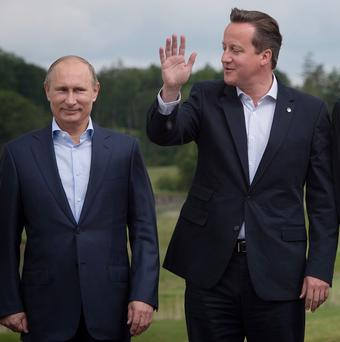 Prime Minister David Cameron with Russian president Vladimir Putin at the G8 Summit on Lough Erne in Enniskillen, Northern Ireland