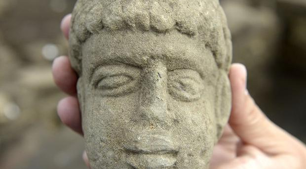 The 1,800-year-old carved stone head of a possible Geordie Roman god