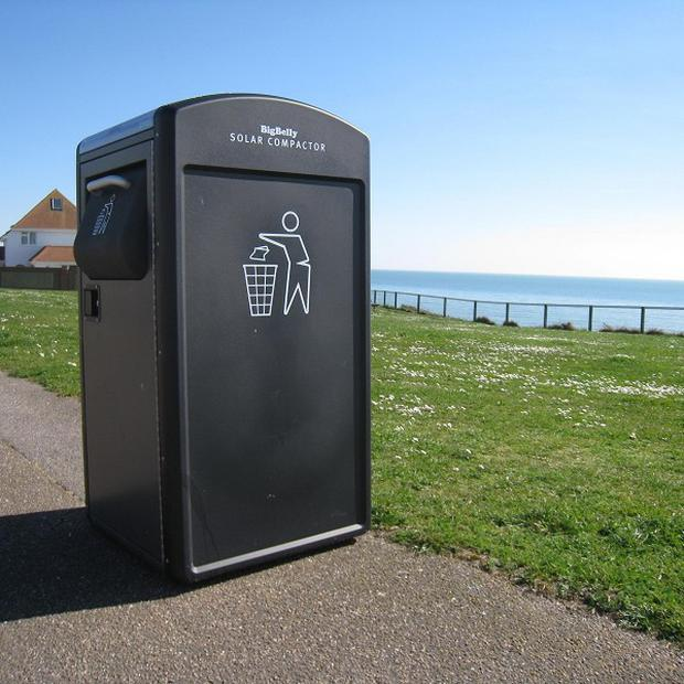 This solar-powered bin in Boscombe, Dorset, sends text messages and emails when it needs emptying